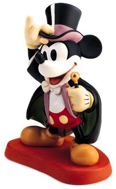 WDCC Disney Classics Mickey Mouse On With The Show #WDCCDisneyClassics #Art. Wand: Edge is brushed with gold metallic paint. Paint Finishes: Range from glossy to matte. Backstamp: 1997 WDCS Membership Gift Sculpture backstamp.