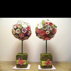 """These topiaries are made up of approximately 60 paper flowers with embellishments.  The flowers were put on a 6"""" foam ball."""