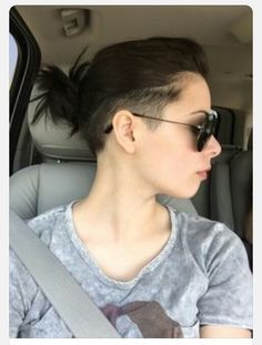 Shaved sides with a messy bun!!
