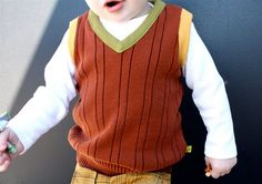 This is a child's sweater vest made from an adult's. I'm going to have to make it soon, because my daughter keeps trying to put her younger brother's vest on, and it doesn't fit her, but she doesn't care. So I have to make at least one for her. I have some sweaters I could part with.