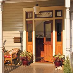 A new door and sidelights, made with reclaimed redwood, get their amber glow from a clear oil finish Victorian Front Doors, Folk Victorian, Victorian Homes, Victorian Porch, Porch Entry, Front Entry, Front Door Design, Modern Home Furniture, Exterior Doors