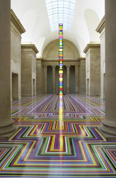 Jim Lambie @ the Tate.  If you go to the MoMA to see anything right now, you'll have to walk over Jim Lambie's work. It is a full on, pop color installation by Jim Lambie made out of vinyl tape. Could be done as a RUG or on STEPS  instead of the whole room.