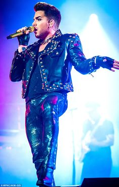 Trendy stubble: Lambert sported some facial hair growth while on stage...