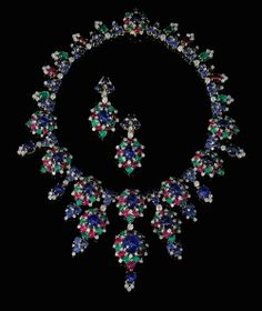 SOTHEBY'S magnificent & Noble Jewels auction Spring 2013. Lot 582, a gem-set and diamond necklace signed Bulgari, circa 1965, designed as a graduated fringe of cluster motifs set with cabochon sapphires, rubies and emeralds highlighted with brilliant-cut diamonds (estimate: 190,000 - 380,000 CHF).