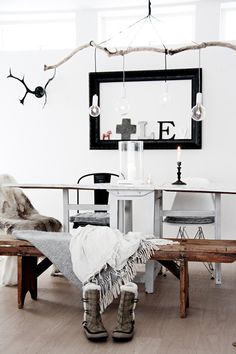 cool idea - branch with decor. mixed up chairs.