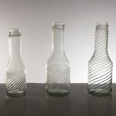A collection of glassware that involves taking processes normally used to engrave and gild crystal glass and applying them to industrial jars and bottles