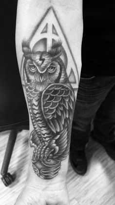 Harry Potter tattoo. Owl with the snitch and deathly hallows symbol. Done by Felix from Lucky Kat Tat in Whiting Indiana