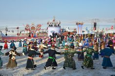 Fun and games: Mongolian people dance during the winter Naadam Fair on the snow-covered pastures in Hulun Buir