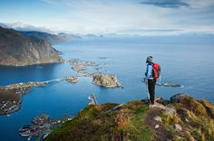Picture of a hiker enjoying the view from Reinebringen, Norway