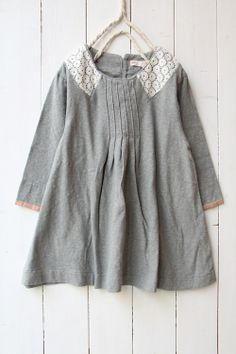 Grey tunic with white lace collar.