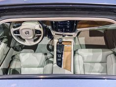 As we peek into the #VolvoS90 from the spacious moonroof, it's apparent that both inside and out of the all-new S90, you can feel the meticulous care and consideration. From the rare Nordic wood to the Sensus touchscreen infotainment system, every detail is a premium expression of true Scandinavian craftsmanship. #NAIAS Volvo Models, Volvo S90, Cars Usa, Volvo Cars, Consideration, Scandinavian, This Is Us, Detail, Contour