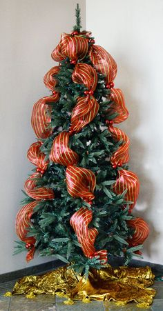 Party Ideas by Mardi Gras Outlet: Quick Christmas Tree Decorating with Tinsel Ties and Deco Mesh