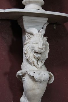https://flic.kr/p/on6Kpt   Detail of a Trapezephoron at Petworth House, Sussex   Detail of a Trapezephoron at Petworth House, Sussex. This is a marble table leg formed by a lion's head with goat's horns (sometimes called a gryphon) and the breast, hind leg and paw of a lion. Five acanthus leaves form a fringe below the neck. This object was bought by Charles Wyndham, second earl of Egremont (1710-1763), in a series of purchases of antiquities between 1755 and 1765 (posthumously) largely…
