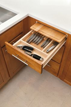 Aristokraft's cutting board drawer organizer has a built-in cutting board insert.  A great cabinet organization idea for kitchens with limited countertop space.