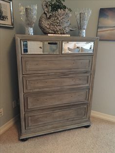 painted my old black dresser with grey chalk paint, a whitewash and rubbed with dark wax. it looks like driftwood...so beachy in snowy Colorado.