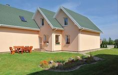 Holiday home Sian�w ul. Sianowska, Osieki Sian�w Featuring a year-round outdoor pool, Holiday home Sian?w ul. Sianowska, Osieki is a holiday home located in Osieki. The unit is 43 km from Ko?obrzeg. Free private parking is available on site.  The kitchen is equipped with an oven. A TV is available.