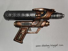 What a neat project. DIY ~ Steampunk Gun of Awesomeness