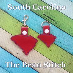 South Carolina - Includes TWO(2) Sizes!  #thebeanstitch #beanstitchers #TBS #ith #inthehoop #machineembroidery #felties #feltie #embroidery #digitaldownload #keyfobs #bagtag #diy #snaptab #snapbean #handmade #vinyl #felt #craft #etsy #shopsmall #embroiderygift #travel #everyday #design #multipurpose #state #SouthCarolina #keychain Kam Snaps, Glitter Vinyl, Tbs, Key Fobs, South Carolina, Machine Embroidery Designs, Free Design, Nerd, Geek Stuff