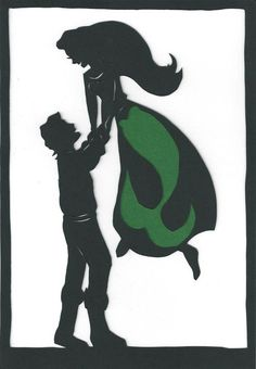 Disney's The Little Mermaid simple shadow decoration. Prince Eric lifting Ariel, human and mermaid version