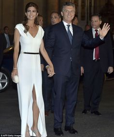 The couple arrive at the Colon Theater  in Buenos Aires to celebrate the new president's inauguration. Juliana showed off her impeccable sense of style in a white belted gown with a thigh high split