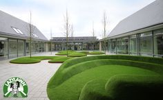 Example of astroturf with built in seating - http://www.lazylawn.co.uk/uploads/images/News/artificial-grass-contours.jpg