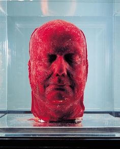 This is Marc Quinn's most famous piece of work, Self, made using 4.5 litres of his own blood, which was slowly extracted from his body over a period of five months and frozen in a cast of his face. Quinn has been making these roughly every five years since 1991, and each one must be maintained carefully in fridges. The fragility of the media means exhibiting is difficult - the head has to be placed into a glass case which is chilled from underneath.