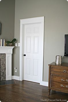Replacing skinny door trim for a bigger, chunkier look!