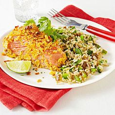 Tortilla-Crusted Salmon with Santa Fe Rice:   Preheat oven to 350. Crush 4 tortilla chips in a ziplock bag. Beat 1 egg. Dip one 4-ounce salmon fillet in egg and coat with crushed tortilla chips. Place on a baking sheet lined with parchment paper and bake 15 mins. Heat 1 tsp olive oil in a medium skillet over medium heat. Sauté 1 minced garlic clove, 2 tbsp chopped green chilies, 2 cups diced bell pepper, and 1/2 cup cooked brown rice 5 mins; stir in 1 tbsp each chopped cilantro and lime juic...