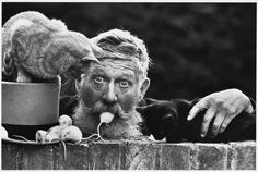Credit: Don McCullin According to McCullin, a postcard of this photograph sold 'like hotcakes' in Australia. McCullin found Snowy, the man in the portrait, standing by the side of the road with an ice-cream barrow in Cambridge, in the early 1970s. He pulled the mouse out of his pocket and put it into his mouth as McCullin took pictures