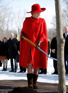 Getting stuck in: Mathilde swapped her heels for brown boots as she took part in a tree pl...