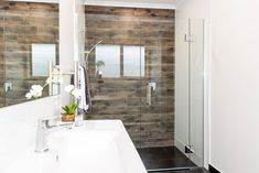 Wood panel wall tiles can bring life to your interiors. Wood Panel Walls, Wood Paneling, Room Tiles, Wall Tiles, Glass Shower, New Builds, Bathrooms, New Homes, Interiors