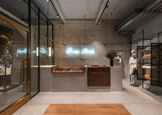 Neri&Hu installs continuous clothing rail in Comme Moi store