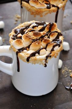 no recipe...hot chocolate (white!?), mini mallows, crumbled graham crackers, torch it, drizzle chocolate syrup...s'more hot choc-lee