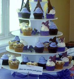 Cute cupcake ideas - chocolate Eiffel Towers and Fleur de Liles