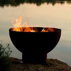"Rick Wittrig's custom crafted steel fire pit with oxidized outside finish and temperature-resistant enamel inside the bowl. Distributed by Thos. Baker. 36""w, 36""d, 24""h, 150 lbs, $795."