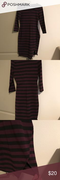 Express Striped Dress Purple and navy blue striped 3/4 sleeve dress. Form fitting with some stretch makes for a flattering fit. Has slit on side, looks classy yet sexy! 95% Cotton 5% Spandex. Express Dresses Midi