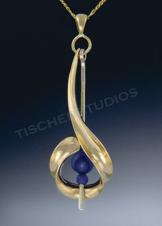 Slideshow of Original Anticlastic Jewelry featuring Pins, Pendants, Bracelets, and Necklaces. These are one of a kind designer pieces with Lapis beads, lapis drops,14k gold and argentium sterling. Hand forged, hand polished art jewelry.