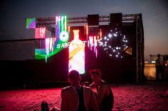 At twilights edge, Sandance party people chill by the glow of the Tagtool Crew LED wall. Light Painting, Twilight, First Time, Dubai, Chill, Glow, Fair Grounds, Abs, Concert