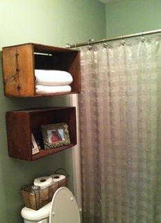 Wooden crates as bathroom shelves