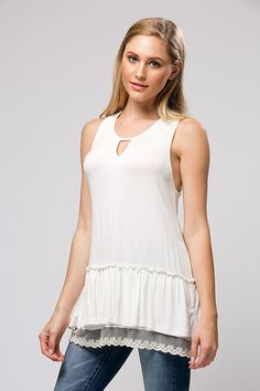 White tank with lace underlay and lace cut out back. $36, S-M-L Purchase here: https://www.facebook.com/photo.php?fbid=10154040040858686&set=g.891556600903617&type=1&theater