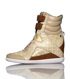 REEBOK Alicia Keys High top women s wedge sneaker Lace up closure with  double velcro straps Cushioned inner sole for comfort Printed throughout 9ca8a017e