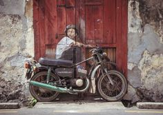 Artist Ernest Zacharevic uses the surroundings of his walls to help finish the works of art that he creates, ending up with some spectacular displays of creativity.