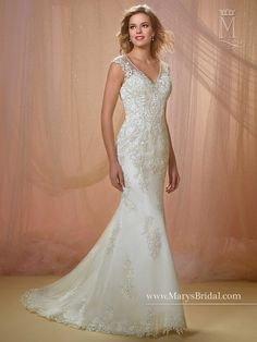 Tulle fit and flare/mermaid bridal gown with embroidery applique, cap sleeves, V-neck, V-back with bead chains, lace hem line, chapel train, and back with zipper and buttons.