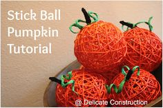 Find simple stick balls at the dollar store and spray paint them orange for pumpkins!