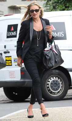 All black everything! Kate Moss, 42, proved why she is one of the world's top models on Friday as she headed to a London pub for lunch with friends in black skinny jeans and a blazer