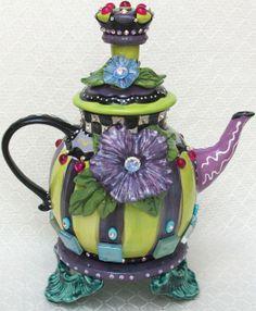 "Royal-tea Teapot, 10""W X 12""H, over 150 Swarovski crystals with glass tiles."