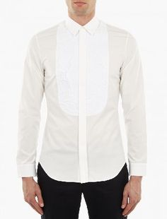Maison Margiela White Bib-Detail Shirt The Maison Margiela Bib-Detail Shirt for SS16, seen here in white. - - This shirt from Maison Margiela is crafted in Italy from premium cotton and features a unique ruffled bib panel to the chest. - - http://www.MightGet.com/january-2017-13/maison-margiela-white-bib-detail-shirt.asp