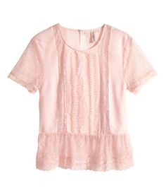 Airy light pink top with lace details & hem ruffle. | H&M Pastels