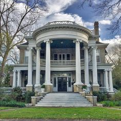 At 215 W.NeoClassic grandeur is achieved by that cavernous curved portico upheld by six enormous Ionic columns. Revival Architecture, Victorian Architecture, Classical Architecture, House Architecture, Victorian Interiors, Victorian Homes, Greek Revival Home, Southern Mansions, Antebellum Homes