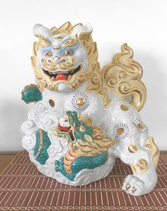 White Japanese Kutani 24k Gilt Foo Dog Shishi Lion with Mythical Sea Dragon . . . Impressed Kutani mark. Super rare!